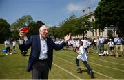 """31 May 2018; Ronnie Delany was guest of honour at his alma mater, CUS Sports Day at College Park, Trinity College. CUS Junior School on Leeson Street is celebrating 150 years of the school. Teachers and children also joined to celebrate the 62nd anniversary of when Ronnie Delany became the first Irish man to break 4 minutes for the mile in Compton, USA, running 3:59.0 on June 1st, 1956, the same year he won gold over 1500m at the Olympic Games in Melbourne. Ronnie Delany is pictured during The Ronnie Delany """"Smile Run"""", at College Park, Trinity College, Dublin. Photo by David Fitzgerald/Sportsfile"""