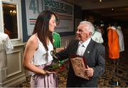 1 June 2018; Women's National Team senior player Megan Campbell with her supporters player of the year award and former Republic of Ireland international John Giles with his outstanding achievement award at the CRISC Player of the Year Awards at  Ballsbridge Hotel, Dublin. Photo by David Fitzgerald/Sportsfile