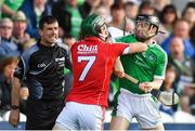 2 June 2018; Mark Coleman of Cork and Graeme Mulcahy of Limerick tangle as linesman Paud O'Dwyer looks on during the Munster GAA Hurling Senior Championship Round 3 match between Cork and Limerick at Páirc Uí Chaoimh in Cork. Photo by Piaras Ó Mídheach/Sportsfile