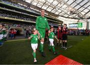 2 June 2018; John O'Shea of Republic of Ireland makes his way onto the pitch with his daughter Ruby and son Alfie prior to the International Friendly match between Republic of Ireland and the United States at the Aviva Stadium in Dublin.. Photo by Stephen McCarthy/Sportsfile