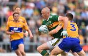 3 June 2018; Kieran Donaghy of Kerry in action against Cillian Brennan of Clare during the Munster GAA Football Senior Championship semi-final match between Kerry and Clare at Fitzgerald Stadium in Killarney, Kerry. Photo by Matt Browne/Sportsfile