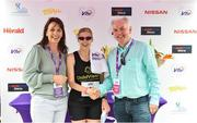 3 June 2018; Visually impaired category winner Sinead Kane is presented with flowers and her prize by Kathy Endersen, CEO, Women's Mini Marathon, left, and John O'Dwyer, Vhi CEO, following the 2018 Vhi Women's Mini Marathon. 30,000 women from all over the country took to the streets of Dublin to run, walk and jog the 10km route, raising much needed funds for hundreds of charities around the country. www.vhiwomensminimarathon.ie Photo by Sam Barnes/Sportsfile