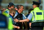 3 June 2018; Referee Alan Kelly is escorted off the field after the Munster GAA Senior Hurling Championship Round 3 match between Waterford and Tipperary at the Gaelic Grounds in Limerick. Photo by Piaras Ó Mídheach/Sportsfile