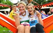 3 June 2018; Participants Isobelle Page and Molly Scott, from England and Edinburgh, with their medals in the Vhi Relaxation zone following the 2018 Vhi Women's Mini Marathon. 30,000 women from all over the country took to the streets of Dublin to run, walk and jog the 10km route, raising much needed funds for hundreds of charities around the country. www.vhiwomensminimarathon.ie Photo by Sam Barnes/Sportsfile