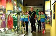 5 June 2018; Celebrating the launch of the new '20 Years' annual exhibition at the GAA Museum are, Senior GAA Museum Tour Guide, Cian Nolan, with from left, Tara Fogarty, 11, Martin Cleere, 12, Cathal Guilfoyle, 12, and Reah Sweeny, 11, all from Tipperary, at Croke Park in Dublin. The exhibition traces the key moments in GAA and Croke Park history over the past 20 years since the GAA Museum first opened its doors in 1998. Topics covered include the Croke Park redevelopment, the deletion of Rule 21, the suspension of Rule 42 that paved the way for international rugby and soccer to be played in Croke Park, the Special Olympics World Summer Games in 2003 and the GAA 125 festivities in 2009. The exhibition also serves as the throw-in for the GAA Museum's anniversary programme of events. Details of all the museum's celebratory activities can be found at www.crokepark.ie/gaamuseum.  Photo by Sam Barnes/Sportsfile
