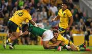 9 June 2018; Bundee Aki of Ireland is tackled by Tolu Latu, left, and Nick Phipps of Australia during the 2018 Mitsubishi Estate Ireland Series 1st Test match between Australia and Ireland at Suncorp Stadium, in Brisbane, Australia. Photo by Brendan Moran/Sportsfile