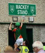 9 June 2018; Bobby Linnane, aged 8, from Swinford, Co. Mayo, assists steward Tom Doran with removing concession signs from outside the ground prior to the GAA Football All-Ireland Senior Championship Round 1 match between Limerick and Mayo at the Gaelic Grounds in Limerick. Photo by Diarmuid Greene/Sportsfile