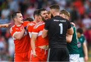 9 June 2018; Mark Lynch of Derry tangles with Kildare goalkeeper Mark Donnellan, before being sent off by referee David Coldrick, during the GAA Football All-Ireland Senior Championship Round 1 match between Derry and Kildare at Derry GAA Centre of Excellence, Owenbeg, Derry. Photo by Piaras Ó Mídheach/Sportsfile