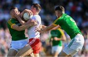 9 June 2018; Pádraig McNulty of Tyrone in action against Conor McGill, left, and Adam Flanagan of Meath during the GAA Football All-Ireland Senior Championship Round 1 match between Meath and Tyrone at Páirc Táilteann in Navan, Co Meath. Photo by Stephen McCarthy/Sportsfile