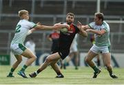 9 June 2018; Seamus O'Shea of Mayo in action against Jim Liston, left, and Darragh Treacy of Limerick during the GAA Football All-Ireland Senior Championship Round 1 match between Limerick and Mayo at the Gaelic Grounds in Limerick. Photo by Diarmuid Greene/Sportsfile