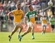 9 June 2018; Declan Hogan of Offaly in action against Matthew Fitzpatrick of Antrim during the GAA Football All-Ireland Senior Championship Round 1 match between Offaly and Antrim at Bord Na Mona O'Connor Park in Tullamore, Offaly. Photo by Sam Barnes/Sportsfile