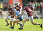 9 June 2018; Rian McBride of Dublin in action against Daivid Burke and Cathal Mannion of Galway during the Leinster GAA Hurling Senior Championship Round 5 match between Galway and Dublin at Pearse Stadium in Galway. Photo by Ray Ryan/Sportsfile