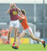 9 June 2018; Mark McCallon of Westmeath in action against Andrew Murnin of Armagh during the GAA Football All-Ireland Senior Championship Round 1 match between Westmeath and Armagh at TEG Cusack Park in Mullingar, Co. Westmeath. Photo by Ramsey Cardy/Sportsfile