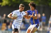 9 June 2018; Killian Clarke of Cavan in action against Ross O'Brien of Wicklow during the GAA Football All-Ireland Senior Championship Round 1 match between Wicklow and Cavan at Joule Park in Aughrim, Wicklow. Photo by Harry Murphy/Sportsfile
