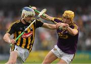 9 June 2018; Luke Scanlon of Kilkenny in action against Damien Reck of Wexford  during the Leinster GAA Hurling Senior Championship Round 5 match between Kilkenny and Wexford at Nowlan Park in Kilkenny. Photo by Ray McManus/Sportsfile