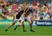 9 June 2018; TJ Reid of Kilkenny in action against Matthew O'Hanlon of Wexford during the Leinster GAA Hurling Senior Championship Round 5 match between Kilkenny and Wexford at Nowlan Park in Kilkenny. Photo by Daire Brennan/Sportsfile