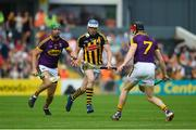 9 June 2018; TJ Reid of Kilkenny in action against Matthew O'Hanlon, left, and Diarmuid O'Keeffe of Wexford during the Leinster GAA Hurling Senior Championship Round 5 match between Kilkenny and Wexford at Nowlan Park in Kilkenny. Photo by Daire Brennan/Sportsfile