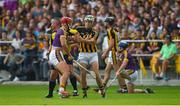 9 June 2018; Referee James McGrath watches play as he stands between Lee Chin of Wexford and Martin Keoghan of Kilkenny, before issuing them both with yellow cards, during the Leinster GAA Hurling Senior Championship Round 5 match between Kilkenny and Wexford at Nowlan Park in Kilkenny. Photo by Ray McManus/Sportsfile