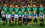9 June 2018; Ireland players, from left, captain Peter O'Mahony, Jack McGrath, Rob Herring, Joey Carbery, Conor Murray, Jordi Murphy and John Ryan stand for the national anthem prior to the 2018 Mitsubishi Estate Ireland Series 1st Test match between Australia and Ireland at Suncorp Stadium, in Brisbane, Australia. Photo by Brendan Moran/Sportsfile