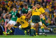 9 June 2018; Jordi Murphy of Ireland is tackled by Will Genia, left, and David Pocock of Australia during the 2018 Mitsubishi Estate Ireland Series 1st Test match between Australia and Ireland at Suncorp Stadium, in Brisbane, Australia. Photo by Brendan Moran/Sportsfile