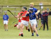 10 June 2018; Joe Fitzgerald of Monaleen, Co Limerick in action against James Kenefick of St Finbarrs, Co Cork during the Division 1 Hurling shield semi-final between St Finbarrs, Co Cork and Monaleen, Co Limerick, at the John West Féile na nGael national competition which took place this weekend across Connacht, Westmeath and Longford. This is the third year that the Féile na nGael and Féile Peile na nÓg have been sponsored by John West, one of the world's leading suppliers of fish. The competition gives up-and-coming GAA superstars the chance to participate and play in their respective Féile tournament, at a level which suits their age, skills and strengths. Photo by Matt Browne/Sportsfile