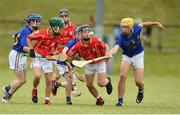 10 June 2018; Joe Fitzgerald of Monaleen, Co Limerick in action against Fionn Crowley of St Finbarrs, Co Cork during the Division 1 Hurling shield semi-final between St Finbarrs, Co Cork and Monaleen, Co Limerick, at the John West Féile na nGael national competition which took place this weekend across Connacht, Westmeath and Longford. This is the third year that the Féile na nGael and Féile Peile na nÓg have been sponsored by John West, one of the world's leading suppliers of fish. The competition gives up-and-coming GAA superstars the chance to participate and play in their respective Féile tournament, at a level which suits their age, skills and strengths. Photo by Matt Browne/Sportsfile