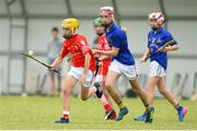 10 June 2018; Ben Murnane of Monaleen, Co Limerick, in action against Cian Buckley of  St Finbarrs, Co Cork, during the Division 1 Hurling shield semi-final between St Finbarrs, Co Cork and Monaleen, Co Limerick, at the John West Féile na nGael national competition which took place this weekend across Connacht, Westmeath and Longford. This is the third year that the Féile na nGael and Féile Peile na nÓg have been sponsored by John West, one of the world's leading suppliers of fish. The competition gives up-and-coming GAA superstars the chance to participate and play in their respective Féile tournament, at a level which suits their age, skills and strengths. Photo by Matt Browne/Sportsfile