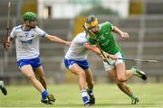 10 June 2018; Colin Coughlan of Limerick is tackled by Rory Furlong of Waterford during the Electric Ireland Munster GAA Hurling Minor Championship match between Limerick and Waterford at the Gaelic Grounds in Limerick. Photo by Ramsey Cardy/Sportsfile
