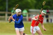 10 June 2018; Ben O'Connor of St Finbarrs, Co Cork, in action against Evan O'Connor of  Monaleen, Co Limerick, during the Division 1 Hurling shield semi-final between St Finbarrs, Co Cork and Monaleen, Co Limerick, at the John West Féile na nGael national competition which took place this weekend across Connacht, Westmeath and Longford. This is the third year that the Féile na nGael and Féile Peile na nÓg have been sponsored by John West, one of the world's leading suppliers of fish. The competition gives up-and-coming GAA superstars the chance to participate and play in their respective Féile tournament, at a level which suits their age, skills and strengths. Photo by Matt Browne/Sportsfile