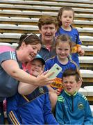 10 June 2018; Tipperary supporter Faustina Renehan takes a picture of Chrissie Renehan, Jamie, age 9, Leah, age 11, and Shauna Ryan, age 7, from Cappawhite, before the Munster GAA Hurling Senior Championship Round 4 match between Tipperary and Clare at Semple Stadium in Thurles, Tipperary. Photo by Ray McManus/Sportsfile