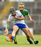 10 June 2018; Jack Ó Floinn of Waterford in action against Colin Coughlan of Limerick during the Electric Ireland Munster GAA Hurling Minor Championship match between Limerick and Waterford at the Gaelic Grounds in Limerick. Photo by Ramsey Cardy/Sportsfile