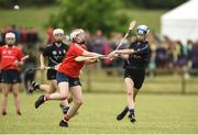 10 June 2018; Evie Twomey of Sarsfields, Co Cork, in action against Sarah Cogley of Carnmore, Co Galway, during the Division 1 Camogie semi-final between Carnmore, Co Galway and Sarsfields, Co Cork, at the John West Féile na nGael national competition which took place this weekend across Connacht, Westmeath and Longford. This is the third year that the Féile na nGael and Féile Peile na nÓg have been sponsored by John West, one of the world's leading suppliers of fish. The competition gives up-and-coming GAA superstars the chance to participate and play in their respective Féile tournament, at a level which suits their age, skills and strengths. Photo by Matt Browne/Sportsfile