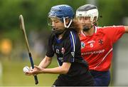 10 June 2018; Eilis Hegarty of Sarsfields, Co Cork, in action against Elsa Iuculano of Carnmore, Co Galway, during the Division 1 Camogie semi-final between Carnmore, Co Galway, and Sarsfields, Co Cork, at the John West Féile na nGael national competition which took place this weekend across Connacht, Westmeath and Longford. This is the third year that the Féile na nGael and Féile Peile na nÓg have been sponsored by John West, one of the world's leading suppliers of fish. The competition gives up-and-coming GAA superstars the chance to participate and play in their respective Féile tournament, at a level which suits their age, skills and strengths. Photo by Matt Browne/Sportsfile