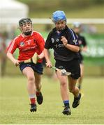 10 June 2018; Caoimhe Galvin of Sarsfields, Co Cork, in action against Ava Killian of Carnmore, Co Galway, during the Division 1 Camogie semi-final between Carnmore, Co Galway and Sarsfields, Co Cork, at the John West Féile na nGael national competition which took place this weekend across Connacht, Westmeath and Longford. This is the third year that the Féile na nGael and Féile Peile na nÓg have been sponsored by John West, one of the world's leading suppliers of fish. The competition gives up-and-coming GAA superstars the chance to participate and play in their respective Féile tournament, at a level which suits their age, skills and strengths. Photo by Matt Browne/Sportsfile