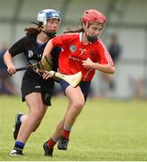 10 June 2018; Aoife Collins of Carnmore, Co Galway, in action against Ella O'Brien of Sarsfields, Co Cork, during the Division 1 Camogie semi-final beteen Carnmore, Co Galway and Sarsfields, Co Cork, at the John West Féile na nGael national competition which took place this weekend across Connacht, Westmeath and Longford. This is the third year that the Féile na nGael and Féile Peile na nÓg have been sponsored by John West, one of the world's leading suppliers of fish. The competition gives up-and-coming GAA superstars the chance to participate and play in their respective Féile tournament, at a level which suits their age, skills and strengths. Photo by Matt Browne/Sportsfile