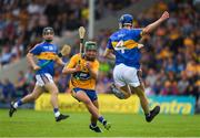 10 June 2018; John Conlon of Clare in action against Donagh Maher of Tipperary during the Electric Ireland Munster GAA Hurling Minor Championship match between Tipperary and Clare at Semple Stadium in Thurles, Tipperary. Photo by Ray McManus/Sportsfile