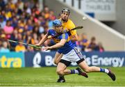 10 June 2018; John McGrath of Tipperary is tackled by Jack Browne of Clare during the Munster GAA Hurling Senior Championship Round 4 match between Tipperary and Clare at Semple Stadium in Thurles, Tipperary. Photo by David Fitzgerald/Sportsfile