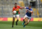 10 June 2018; Jordan Morrissey of Carlow in action against Stephen Attride of Laois during the Leinster GAA Football Senior Championship Semi-Final match between Carlow and Laois at Croke Park in Dublin. Photo by Daire Brennan/Sportsfile