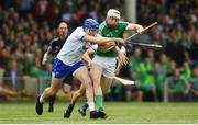 10 June 2018; Cian Lynch of Limerick in action against Austin Gleeson of Waterford during the Munster GAA Hurling Senior Championship Round 4 match between Limerick and Waterford at the Gaelic Grounds in Limerick. Photo by Ramsey Cardy/Sportsfile