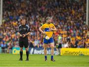 10 June 2018; Referee Paud O'Dwyer and Tony Kelly of Clare  await a 'hawk eye' decision during the Munster GAA Hurling Senior Championship Round 4 match between Tipperary and Clare at Semple Stadium in Thurles, Tipperary. Photo by Ray McManus/Sportsfile