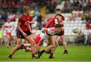 10 June 2018; Darragh Rafferty of Derry in action against Oisin McConvey of Down during the Eirgrid Ulster GAA Football U20 Championship match between Down and Derry at St Tiernach's Park in Clones, Monaghan. Photo by Philip Fitzpatrick/Sportsfile