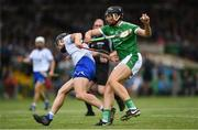 10 June 2018; Gearoid Hegarty of Limerick pushes off the tackle by Pauric Mahony of Waterford on his way to scoring his side's second goal during the Munster GAA Hurling Senior Championship Round 4 match between Limerick and Waterford at the Gaelic Grounds in Limerick. Photo by Ramsey Cardy/Sportsfile