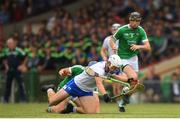 10 June 2018; Tom Devine of Waterford is tackled by Mike Casey of Limerick  during the Munster GAA Hurling Senior Championship Round 4 match between Limerick and Waterford at the Gaelic Grounds in Limerick. Photo by Eóin Noonan/Sportsfile