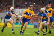 10 June 2018; David Reidy of Clare in action against Brendan Maher, left, and Seán O'Brien of Tipperary during the Munster GAA Hurling Senior Championship Round 4 match between Tipperary and Clare at Semple Stadium in Thurles, Tipperary. Photo by Ray McManus/Sportsfile