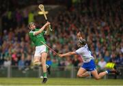 10 June 2018; David Dempsey of Limerick has his shot blocked by Philip Mahony of Waterford during the Munster GAA Hurling Senior Championship Round 4 match between Limerick and Waterford at the Gaelic Grounds in Limerick. Photo by Eóin Noonan/Sportsfile