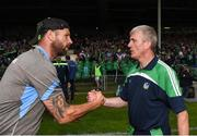 10 June 2018; Waterford selector Dan Shanahan shakes hands with Limerick manager John Kiely following the Munster GAA Hurling Senior Championship Round 4 match between Limerick and Waterford at the Gaelic Grounds in Limerick. Photo by Eóin Noonan/Sportsfile