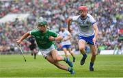 10 June 2018; Sean Finn of Limerick in action against DJ Foran of Waterford during the Munster GAA Hurling Senior Championship Round 4 match between Limerick and Waterford at the Gaelic Grounds in Limerick. Photo by Ramsey Cardy/Sportsfile