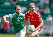 10 June 2018; Connor Grimes of Louth in action against Adrian Moyles of London during the GAA Football All-Ireland Senior Championship Round 1 match between London and Louth at McGovern Park in Ruislip, London. Photo by Matt Impey/Sportsfile