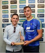 10 June 2018; Presenting Peter Duggan of Clare with his Man of the Match award following the meeting of Tipperary and Clare at Semple Stadium, is Bord Gáis Energy customer David Cody, Company Director at Tipperary Glass. Bord Gáis Energy offers its customers unmissable rewards throughout the Championship season, including match tickets and hospitality, access to training camps with Hurling stars and the opportunity to present Man of the Match Awards. Photo by David Fitzgerald/Sportsfile