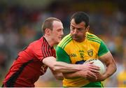 10 June 2018; Frank McGlynn of Donegal in action against Shay Millar of Down during the Ulster GAA Football Senior Championship Semi-Final match between Donegal and Down at St Tiernach's Park in Clones, Monaghan. Photo by Philip Fitzpatrick/Sportsfile